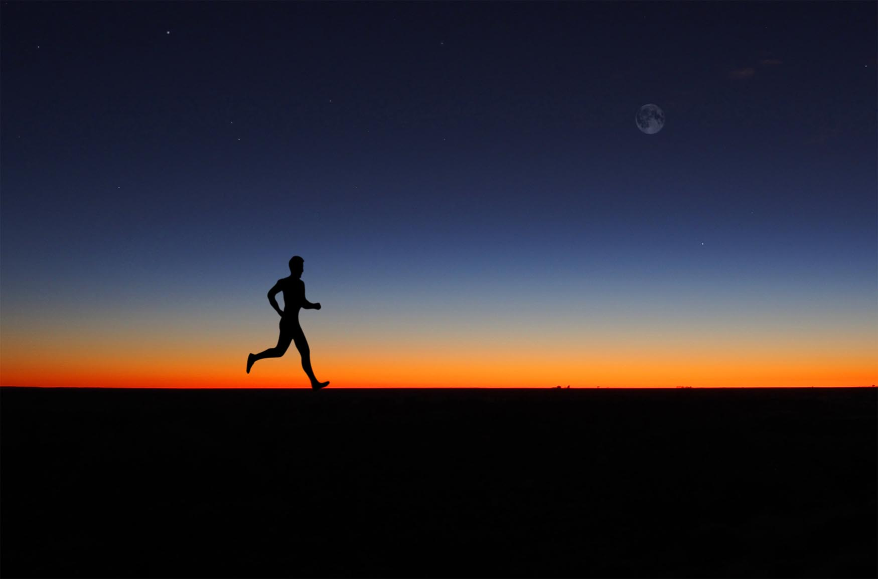 Man running alone at dawn